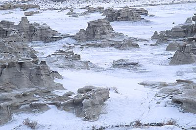 badlands with snow